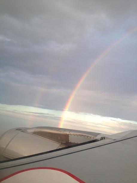 A double rainbow on our flight